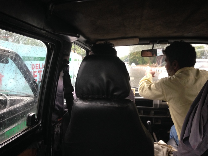 A furtive shot from inside the replacement rickshaw van. Cuticles trimmed. Drivers gesticulating at traffic. All is well.
